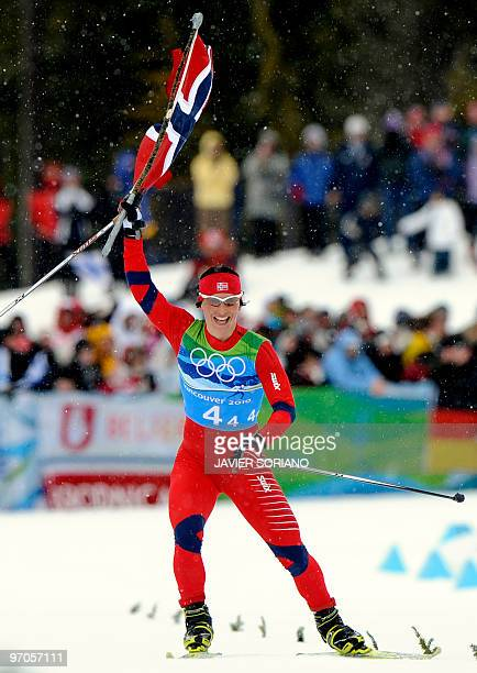 Norway's Marit Bjoergen reacts as she crosses the finish line in the women's Cross Country Skiing 4x5 km relay at Whistler Olympic Park during the...
