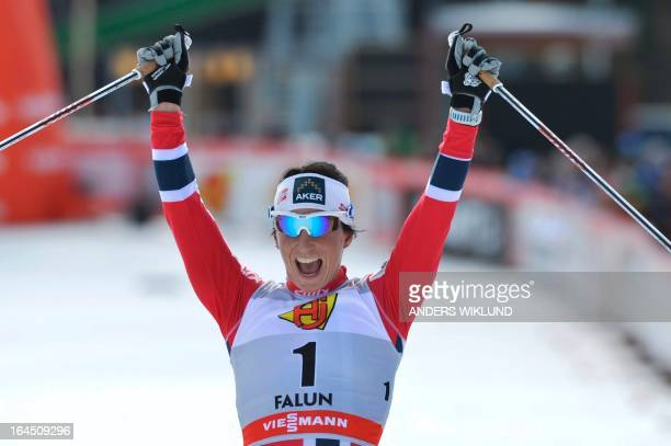 Norway's Marit Bjoergen reacts as she passes the finish line of the women's 10km Free start event of the FIS Cross Country World Cup Final in Falun...