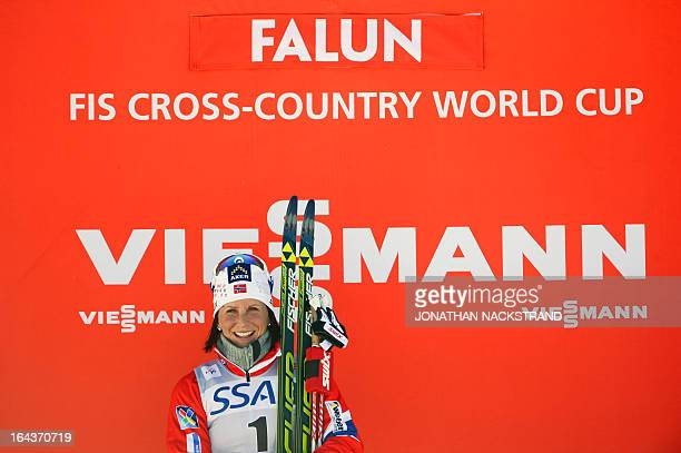 Norway's Marit Bjoergen reacts during the winner's ceremony after the FIS CrossCountry World Cup Ladies 10 km Classic Mass Start in Falun Sweden on...