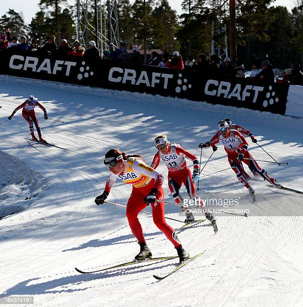 Norway's Marit Bjoergen Therese Johaug and Poland's Justyna Kowalczyk compete during the FIS CrossCountry World Cup Ladies 10 km Classic Mass Start...