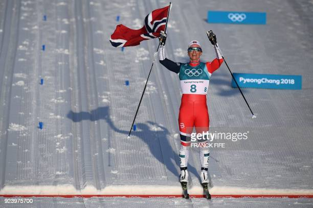 TOPSHOT Norway's Marit Bjoergen wins the women's 30km cross country mass start classic at the Alpensia cross country ski centre during the...
