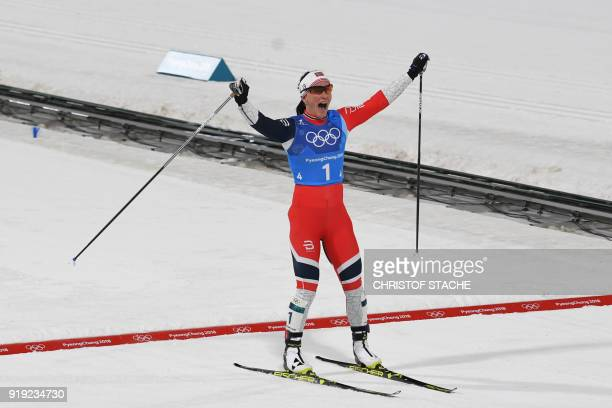 TOPSHOT Norway's Marit Bjorgen celebrates wining the women's 4x5km classic free style cross country relay at the Alpensia cross country ski centre...