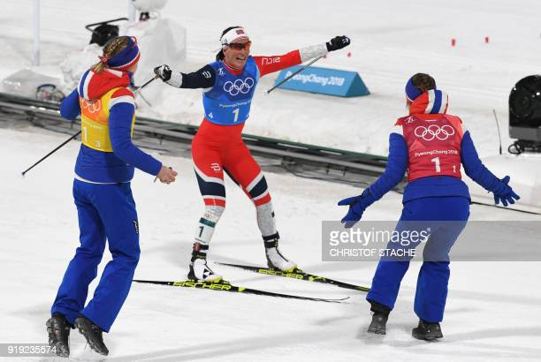 TOPSHOT Norway's Marit Bjorgen celebrates with her teammates after the women's 4x5km classic free style cross country relay at the Alpensia cross...