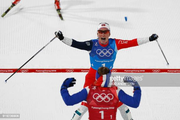 TOPSHOT Norway's Marit Bjorgen celebrates with Norway's Ingvild Flugstad Oestberg after winning the women's 4x5km classic free style cross country...
