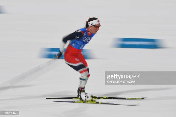 TOPSHOT Norway's Marit Bjorgen competes during the women's 4x5km classic free style cross country relay at the Alpensia cross country ski centre...