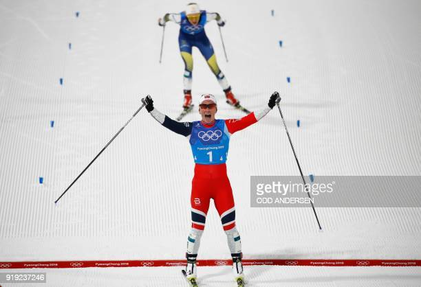 TOPSHOT Norway's Marit Bjorgen crosses the finish line ahead of Sweden's Stina Nilsson the women's 4x5km classic free style cross country relay at...