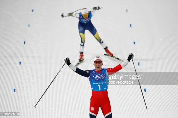 Norway's Marit Bjorgen crosses the finish line first during the women's 4x5km classic free style cross country relay at the Alpensia cross country...