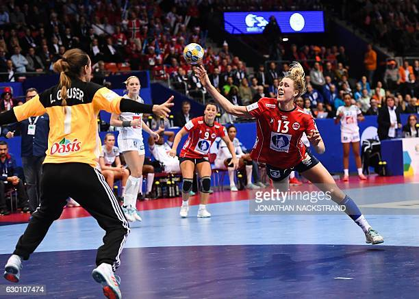 Norway's Marit Malm Frafjord prepares to throw the ball during the Women's European Handball Championship semi final match between France and Norway...