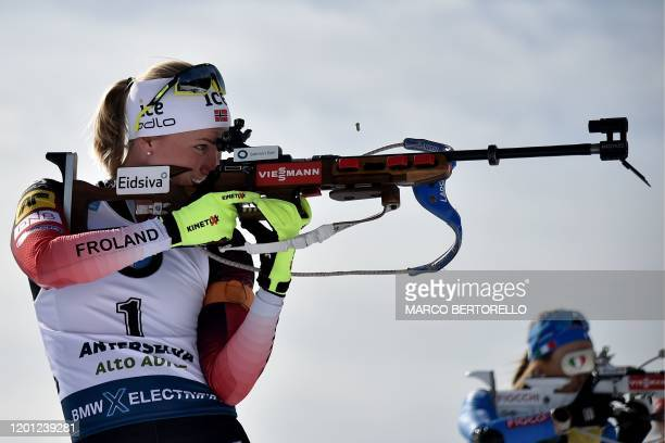 Norway's Marte Olsbu Roeiseland and Italy's Dorothea Wierer compete at the shooting range in the IBU Biathlon World Cup 10 km Women's pursuit in...
