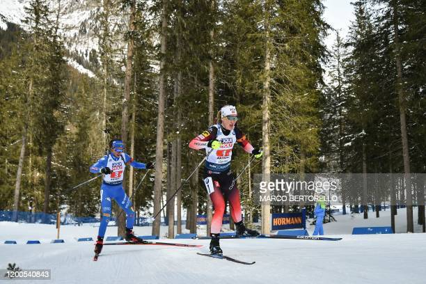 Norway's Marte Olsbu Roeiseland and Italy's Lisa Vittozzi compete in the IBU Biathlon World Cup 4x6 Mixed Relay in RasenAntholz Italian Alps on...