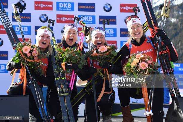 Norway's Marte Olsbu Roeiseland Ingrid Landmark Tandrevold Tiril Eckhoff and Synnove Solemdal celebrate on the podium after winning the Women 4x6 km...