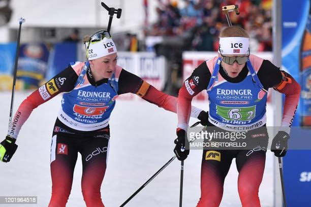 Norway's Marte Olsbu Roeiseland passes the relay to Norway's Johannes Thingnes Boe during the IBU Biathlon World Cup Single Mixed Relay in...