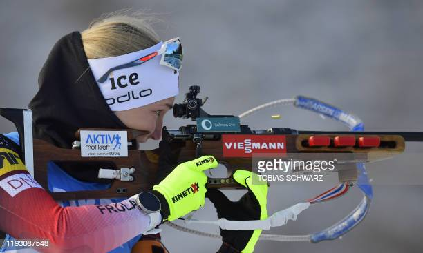 Norway's Marte Olsbu Roeiseland reloads her rifle during the zeroing for the women's 4x6kms relay event at the IBU World Biathlon Championships in...