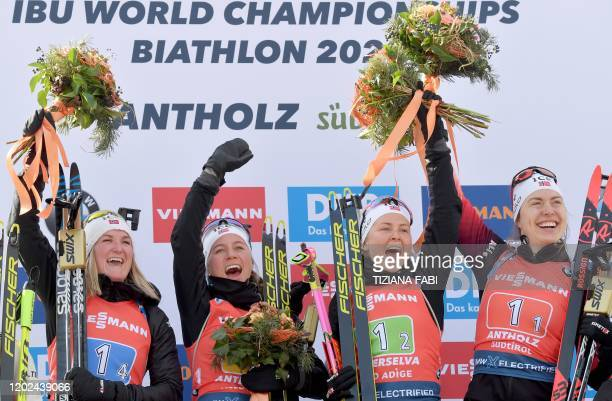 Norway's Marte Olsbu Roeiseland Tiril Eckhoff Ingrid Landmark Tandrevold and Synnove Solemdal celebrate on the podium after winning the Women 4x6 km...