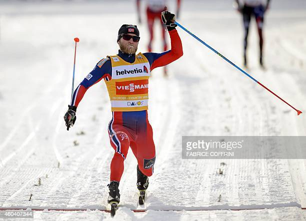 Norway's Martin Johnsrud Sundby celebrates as he crosses the finish line to win the men's 15km classic individual race at the Nordic skiing FIS...