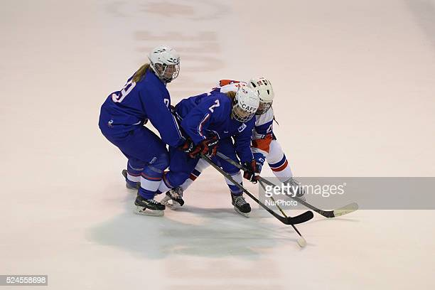 Norway's Mathea Fisher in action challenged by France's Alisson Obre and Marion Allemoz during the first day of the Ice Hockey Four Nations...