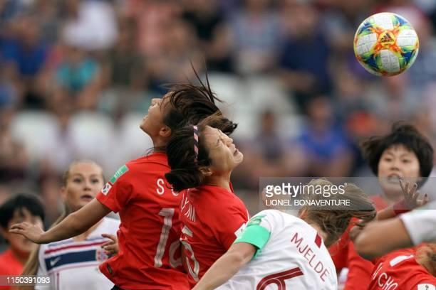 Norway's midfielder Caroline Hansen and South Korea's defender Kim Do-yeon vie for the ball with Norway's defender Maren Mjelde during the France...