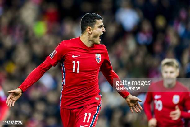 Norway's midfielder Mohamed Elyounoussi celebrates after scoring the 1-0 goal during the FIFA World Cup Quatar 2022 qualification Group G football...