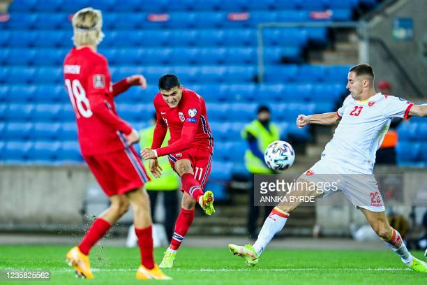 Norway's midfielder Mohamed Elyounoussi scores the 2-0 during the FIFA World Cup Quatar 2022 qualification Group G football match between Norway and...
