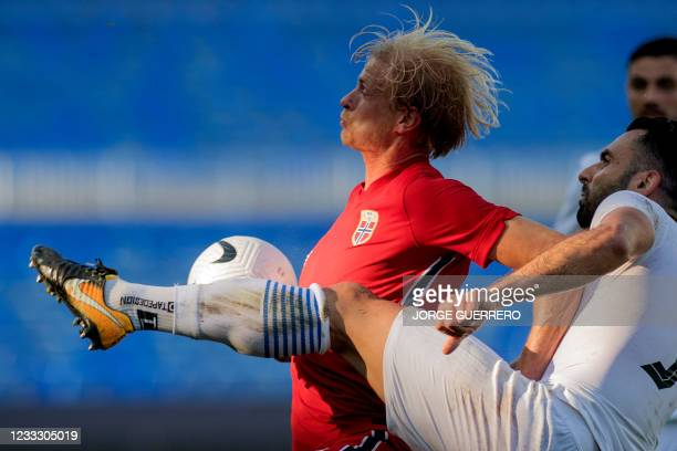 Norway's midfielder Morten Thorsby challenges Greece's defender Giorgos Tzavellas during the international friendly football match between Norway and...