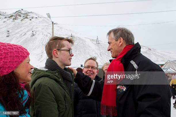 Norway's Minister for Foreign Affairs Jonas Gahr Stoere talks with Viljar Hanssen during a celebration of Soldagen in Longyearbyen on March 8 2012...