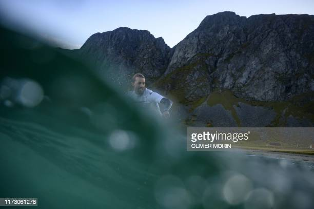 TOPSHOT Norway's national team surfer Frode Goa rides a wave in Unstad Lofoten Islands beyond the Arctic Circle on September 28 during the Open men...