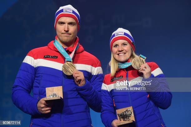Norway's new bronze medallists Kristin Skaslien and Magnus Nedregotten pose on the podium during a partial medal ceremony for the curling mixed...