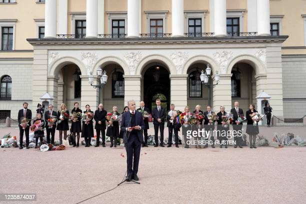 Norway's new Prime Minister Jonas Gahr Store and ministers of his cabinet pose on Slottsplassen palace square in front of the Royal Palace in Oslo,...