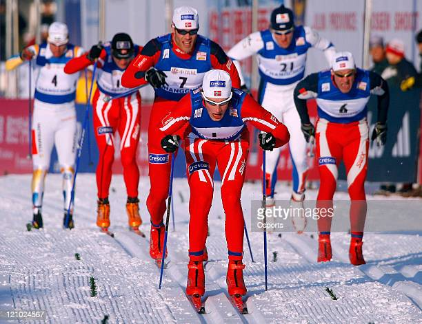 Norway's Oestenssen Simen Naess Boerre Iversen Trond and Estonia's Kummel Peeter compete in the men's 12 km sprint race at the 2007 FIS World Cup...