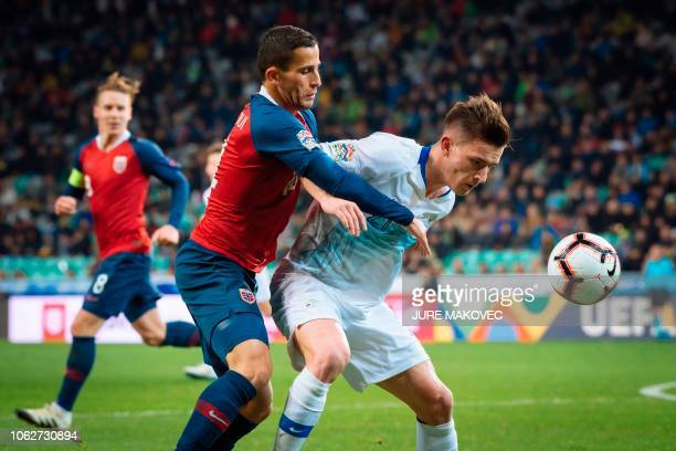 Norway's Omar Elabdellaoui vies for the ball with Benjamin Verbic of Slovenia during the UEFA Nations League football match between Slovenia and...