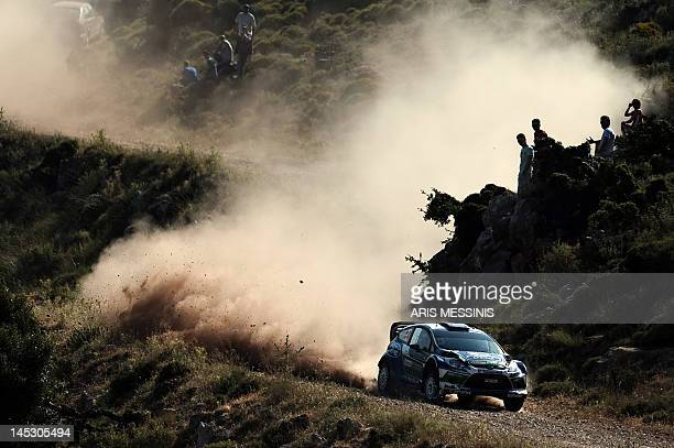 Norway's Petter Solberg and British codriver Chris Patterson drive their Ford Fiesta RS during the Klenia special stage of the WRC Acropolis rally in...