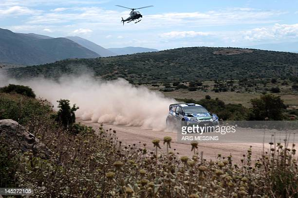Norway's Petter Solberg and his British codriver Chris Patterson drive their Ford Fiesta RS WRC during the Bauxites special stage of the WRC...