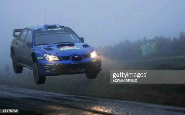 Norway's Petter Solberg driving a Subaru Impreza World Rally Car takes off during Stage 1 Port Talbot of the Wales Rally GB near Swansea in Wales 30...
