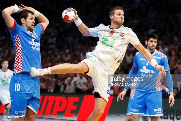 Norway's pivot Bjarte Myrhol jumps to shoot on goal and score his team's first goal during the 25th IHF Men's World Championship 2017 semi-final...