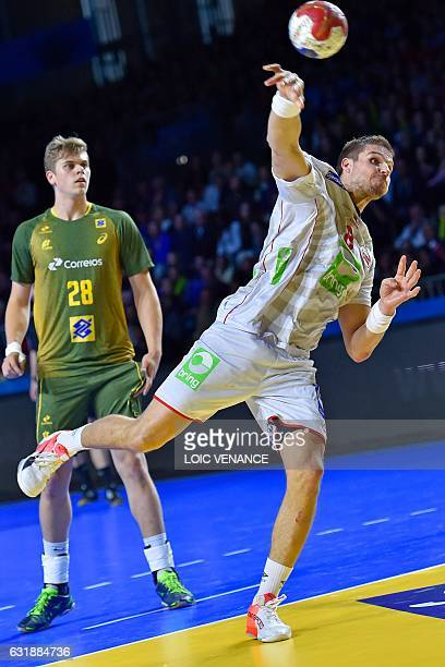 Norway's pivot Bjarte Myrhol shoots on goal under the eye of Brazil's right back Gabriel Ceretta during the 25th IHF Men's World Championship 2017...