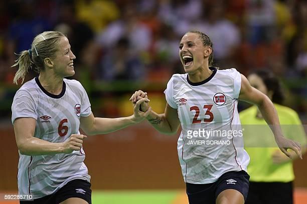 Norway's pivot Heidi Loke and Norway's left wing Camilla Herrem celebrate a goal during the women's Bronze Medal handball match Netherlands vs Norway...