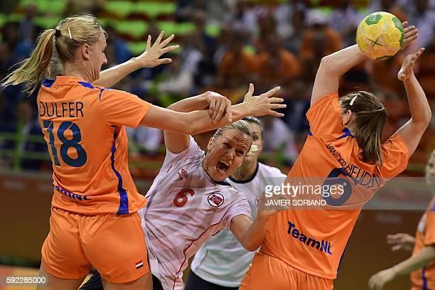 Norway's pivot Heidi Loke vies with Netherlands' left back Kelly Dulfer and Netherlands' right back Laura van der Heijden during the women's Bronze...