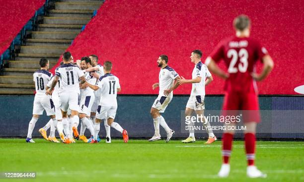 Norway's player Erling Braut Haaland looks on as Serbia's players cheer over the 0-1 goal scored by Sergej Milinkovic-Savic during the Euro 2020...