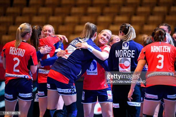 Norway's players celebrate their victory after the semi-final match between Denmark and Norway of the 2020 EHF European Women's Handball Championship...