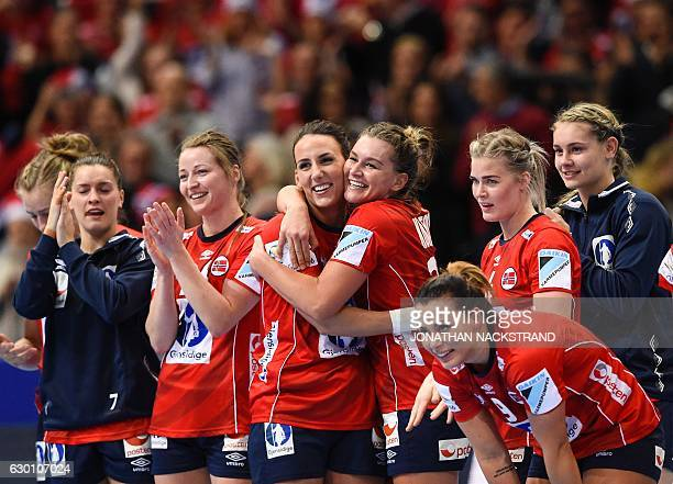 Norway's players celebrate their victory after the Women's European Handball Championship semi final match between France and Norway in Gothenburg...
