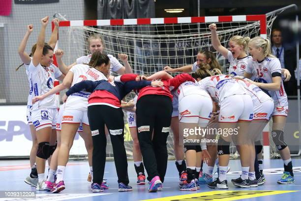 Norway's players celebrate their victory and advancement into the quarterfinals after the World Women's HandballChampionship match round of 16 match...