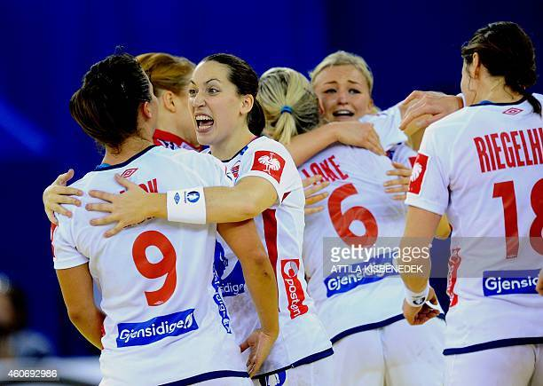 Norway's players celebrate their victory over Sweden in Papp Laszlo Arena of Budapest on December 19 2014 during their semifinal match of Women's...