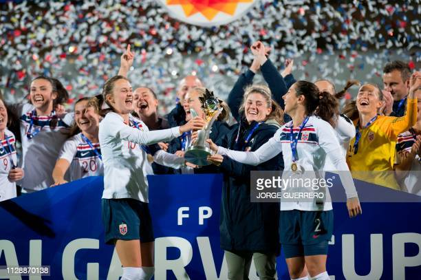 Norway's players celebrate winning the Algarve Cup final football match between Poland and Norway at the Estadio Municipal da Bela Vista in Parchal...