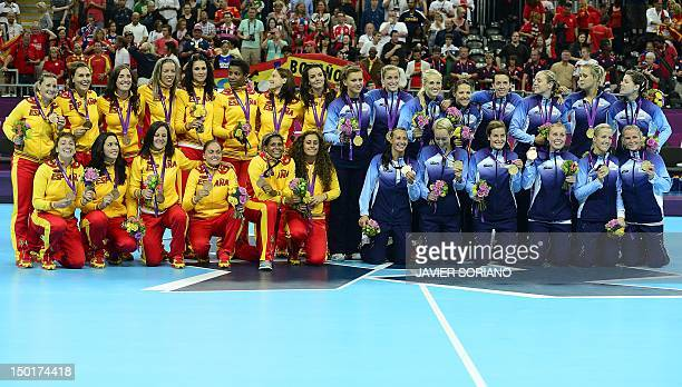 Norway's players pose with their gold medals next to bronze medalists team Spain after the podium ceremony of the women's gold medal handball match...