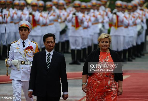 Norway's Prime Minister Erna Solberg and her Vietnamese counterpart Nguyen Tan Dung review and honour guard during a welcoming ceremony at the...