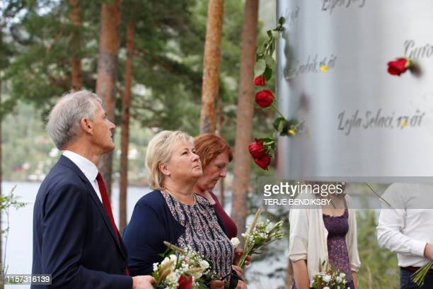 Norway's Prime Minister Erna Solberg and the leader of the Labour party Jonas Gahr Stoere attend a tribute ceremony to the 69 people killed eight...
