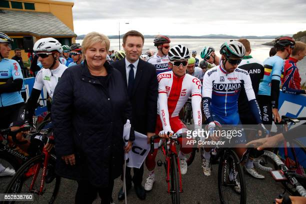 Norways Prime Minister Erna Solberg and UCI President David Lappartient pose before the start of the Men Elite Road Race during the UCI 2017 Road...