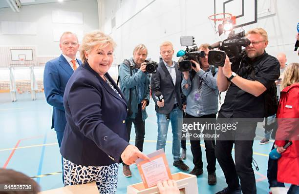 Norway`s Prime Minister Erna Solberg cast her ballot flanked by her husband Sindre Finnes at a polling station in Bergen during general election on...