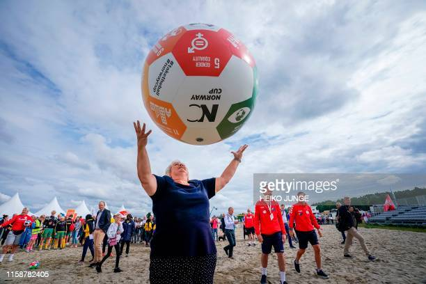 Norway's Prime Minister Erna Solberg plays with a giant football at the Norway Cup at Ekebergsletta in Oslo on July 31 2019 The ball is a symbol to...