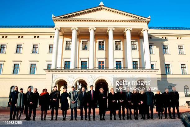 Norway´s Prime Minister Erna Solberg poses with members of her cabinet as she presents her new government in front of the Royal Palace in Oslo on...